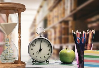 Digital composition of hour glass, alarm clock, apple and pen holder against library in background